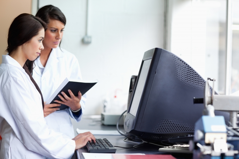 3649681-female-scientists-using-a-monitor
